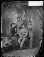 Three male Pueblo students with Miss Shields [version 1], c.1883