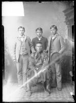 Osage chief with three male students, c.1891