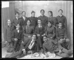 Teacher Miss Burgess with thirteen students, 1898