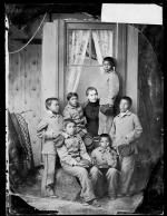 Six young male students with teacher Miss Shiverick, c.1882