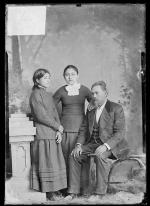 Martha Moore and Ella Moore with their father, John R. Moore [version 1], c.1882