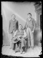 Black Dog and two male students, c.1895