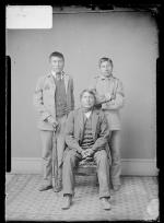 Native American man with two male students, c.1882